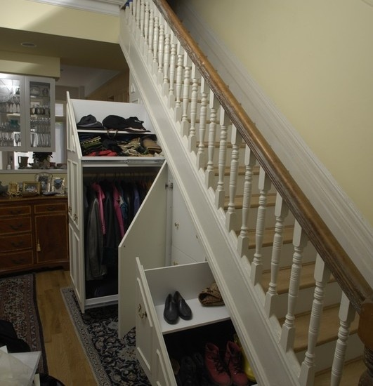 Cabinets: Traditional Closet With The Storage Compartments Under Stairs  Large Coat Rack Middle Section With 3 Drawers And Small Shoe Drawer Eft  Side Of The ...