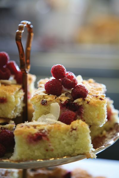 Raspberry & Coconut Slice  In this recipe, raspberries can be substituted with blueberries or blackberries. The berries can be fresh or frozen – both work well.    6 egg whites  2 cups (320g) icing sugar, sieved  2 cups (200g) fine desiccated coconut  ½ cup (75g) self-raising flour, sieved  175g unsalted butter, melted  1½ cups (175g) raspberries
