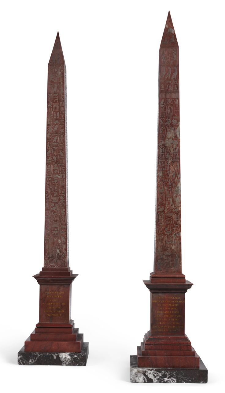 A pair of Italian 'Grand Tour' rosso antico obelisks, 19th century one being a reduction of the Obelisco Lateranense in Piazza San Giovanni in Laterano, transferred to Rome by the Emperor Constanzo and re-erected by Pope Sistus V in 1588; the other of the Obelisco Flaminio in Piazza del Popolo, the second oldest obelisk after the Lateransensis, transferred to Rome by Emperor Augustus, and re-erected by Pope Sixtus in 1589. each 96cm. high; 3ft. 1¾in.