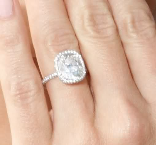 loveeeee...simple and delicate cushion cut engagement ring.....5ish carats....