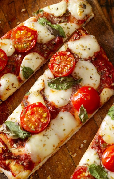 """The Three Pizza Recipes All Italians Swear By. Even in Italy, not all pizzas are alike. There's the kind """"al taglio""""—cut into squares—that are usually a little thick. This pizza is made by putting the..."""