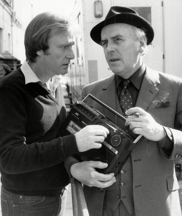 On the set of Minder with Dennis Waterman. He was known for the trilby and coat he still wears today