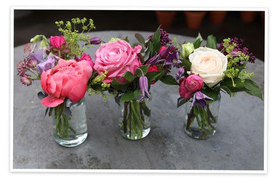 Patio Flower Pot Arrangements | We loved these jam jar arrangements that were on display at the shop.