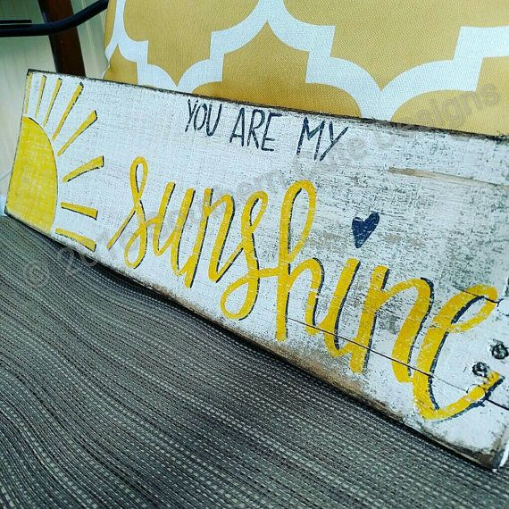 You are my Sunshine wood pallet sign!    Perfect for a play room or childs nursery! You can also add a touch of sunshine to any room in your home, with this rustic wood sign.   This sign is completely hand painted by me, no vinyl letters or stencils are used!    Approximately 5x18 with hardware attached. This sign has a beautiful hand drawn sunshine in the left corner with hand lettered charcoal grey and yellow lettering and grey shadowing.  I hand letter and paint each and every sign that…