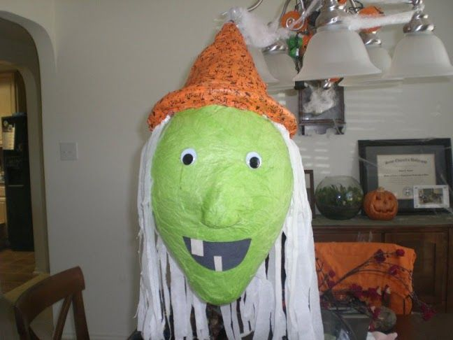 Paper mache witch. I used a large balloon, white streamers for the ...