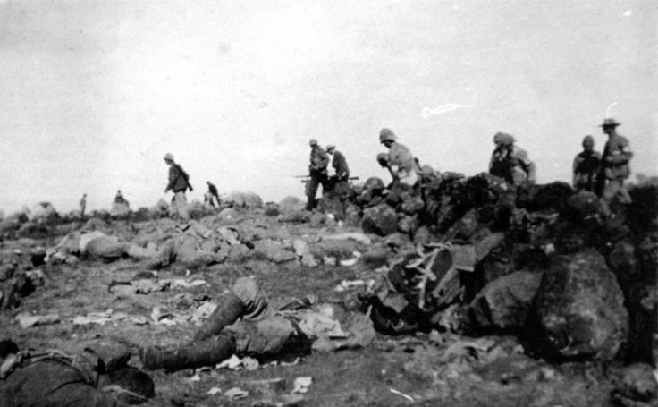 Following the Battle of Spion Kop on January 24th, British ambulancemen and Boer fighters walk over the battlefield under a flag of truce, looking for the wounded. Although the British took significant casualties, and retreated from the field, the loss was not a major setback for the British, who fell back in good order, unpursued by the Boers. The British soon resumed their advance, and reached Ladysmith about a month later. (McGregor Museum)