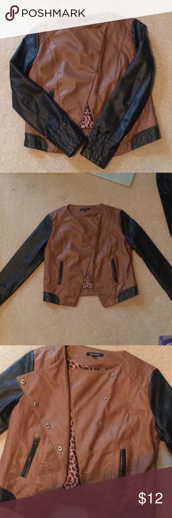 Brown & Black Faux Leather Jacket - Size L Faux Leather Jacket - Size L. Button closure in the middle, zipper pockets on both sides. Brown chest with black sleeves. Cheetah print fabric on the inside. zinga Jackets & Coats
