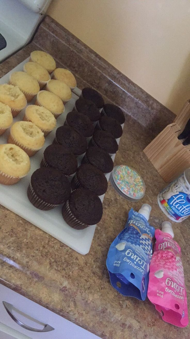 How to make gender reveal cupcakes. Steps: bake cupcakes, refrigerate, spoon out the inside, insert blue or pink filling, place white frosting on top and sprinkle :-)
