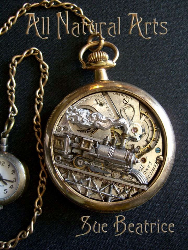 Pocket watch sculptures by Sue Beatrice. See more on facebook/allnaturalarts. Contact: allnaturalarts @ aol.com for commission and pricing information.