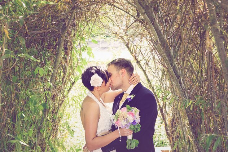 Kissing under an arch  Photos by mckenzie brown photography