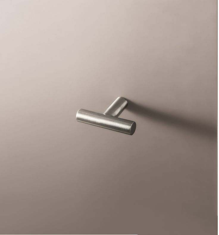 The Young wall-mount towel hook in brushed stainless steel by Fantini is a sleek and minimalist way to add style to your space.