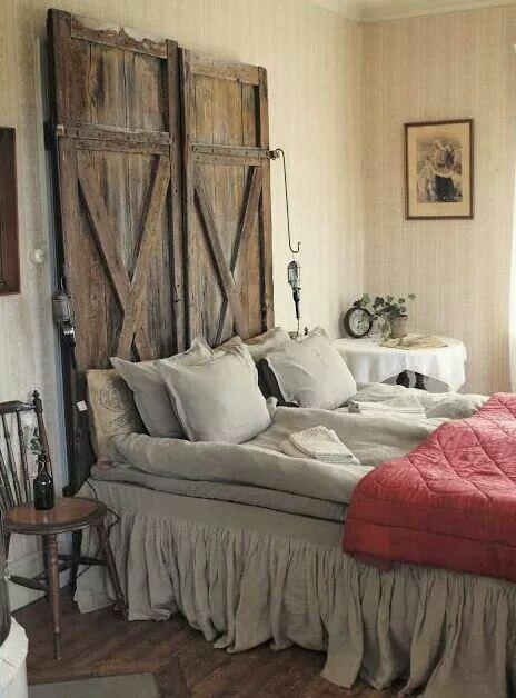 Wooden door headboard hanging shop lights feathered bed antique rustic country