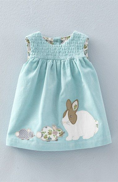 Appliquéd bunnies and chicks make this old-fashioned smock the perfect choice for your little girl's Easter outfit.