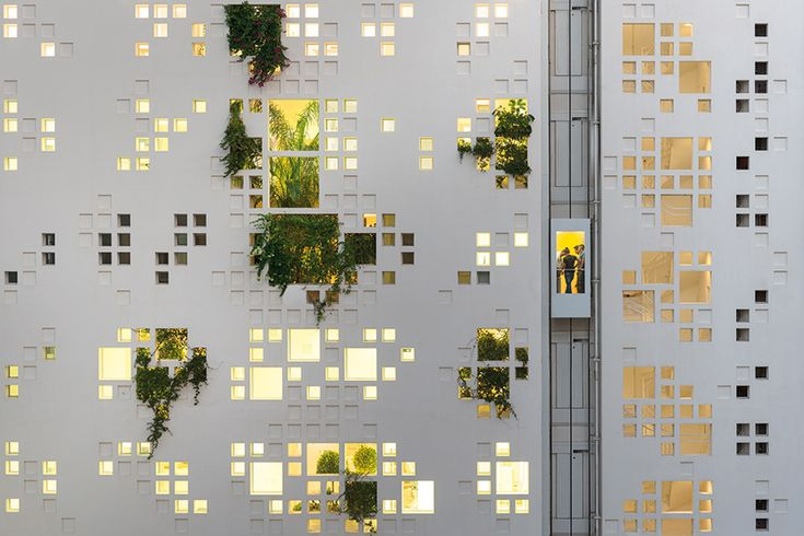 Green invention. A pixelated view of outside and inside world.  jean-nouvel-white-walls-tower-nicosia-cyprus-designboom-02