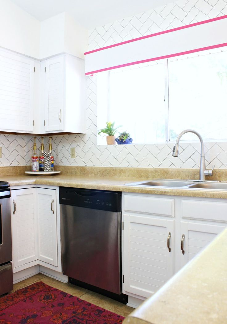 By far this is the best way to paint your cabinets! Love the clean, beautiful outcome. Click for tutorial