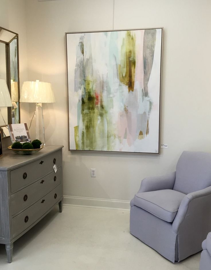 Lynn Sanders Art - pale colors of this abstract painting add to the serenity of the gray furniture in this room.