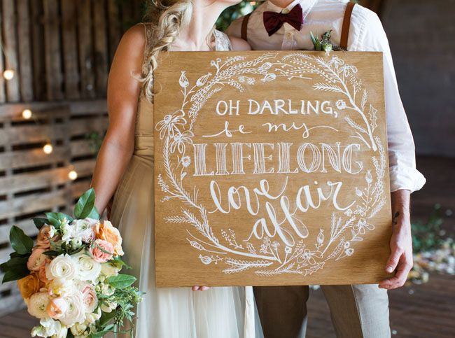 calligraphy sign | via: green wedding shoes