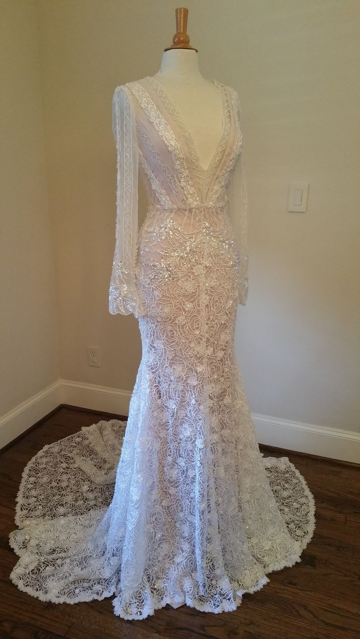 This long sleeve wedding dress was a custom gown we created for a client who asked us to make a replica of an Inbal Dror.  The original was over eight thousand. Our replicated version is way less! We can work from any picture you have to create a design you can afford. Get pricing on custom wedding dresses & replicas at https://www.dariuscordell.com/shop/wedding-dresses/bridal-samples-inexpensive-wedding-gowns/v-neck-long-sleeve-wedding-dresses-inspired-inbal-dror/
