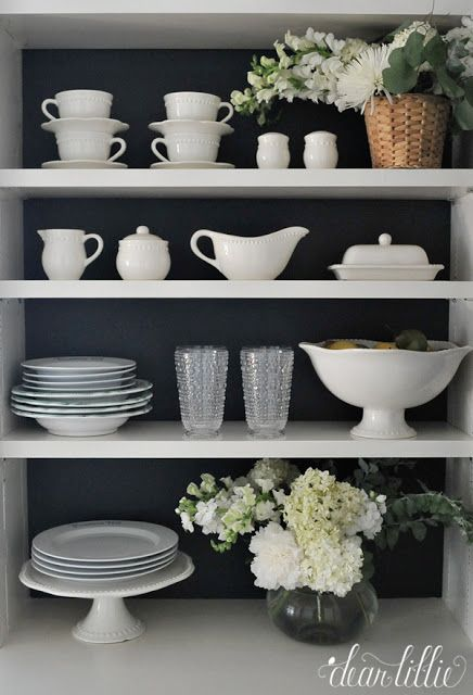 Painting the back of these shelves dark helps make these dishes really pop in this butler's pantry. And we love how these beautiful glasses from HomeGoods look in this space. (sponsored pin)