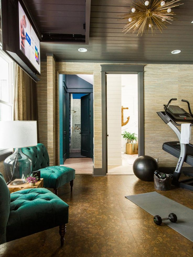 Burn calories and work off stress in this user-friendly home gym that offers top-notch equipment and exercise accessories in a stylish setting with a great view of the backyard.