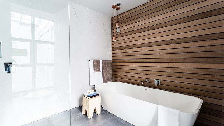 """Shannon & Simon's bathroom.  Love the timber feature wall, the slanting of the """"normal"""" tiles and the taps."""