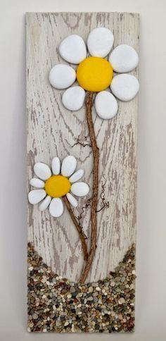 Pallet Art masterpiece. It's a rock art DIY project that's easy to make #flowers #rocks #art