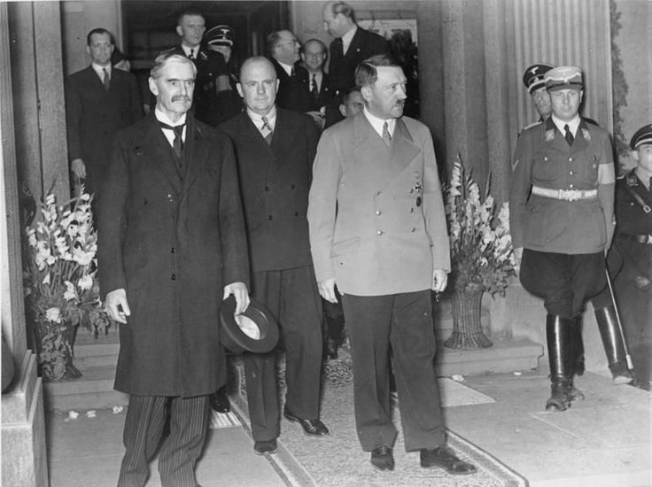 Chamberlain (front left) meets with Hitler (front right) in September 1938, a year before Germany invades Poland. The Munich Accord the men negotiated at this meeting would be violated by Hitler's invasion of Poland. (German Federal Archives) chamberlain_and_hitler