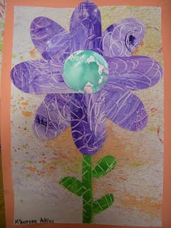 Scratch painting and then spray with tempra to make an Eric Carle like flower from The Tiny Seed