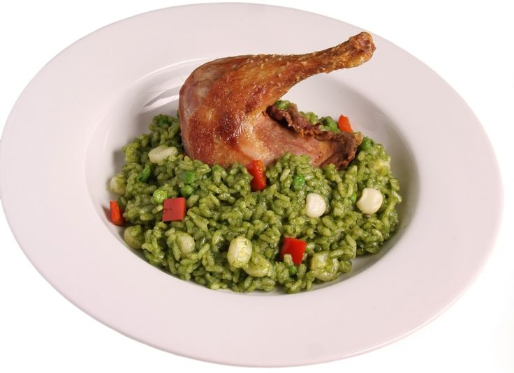 Arroz con pollo, green is in    HEARTY CHICKEN WITH GREEN CILANTRO RICE AND VEGETABLES.-Peru