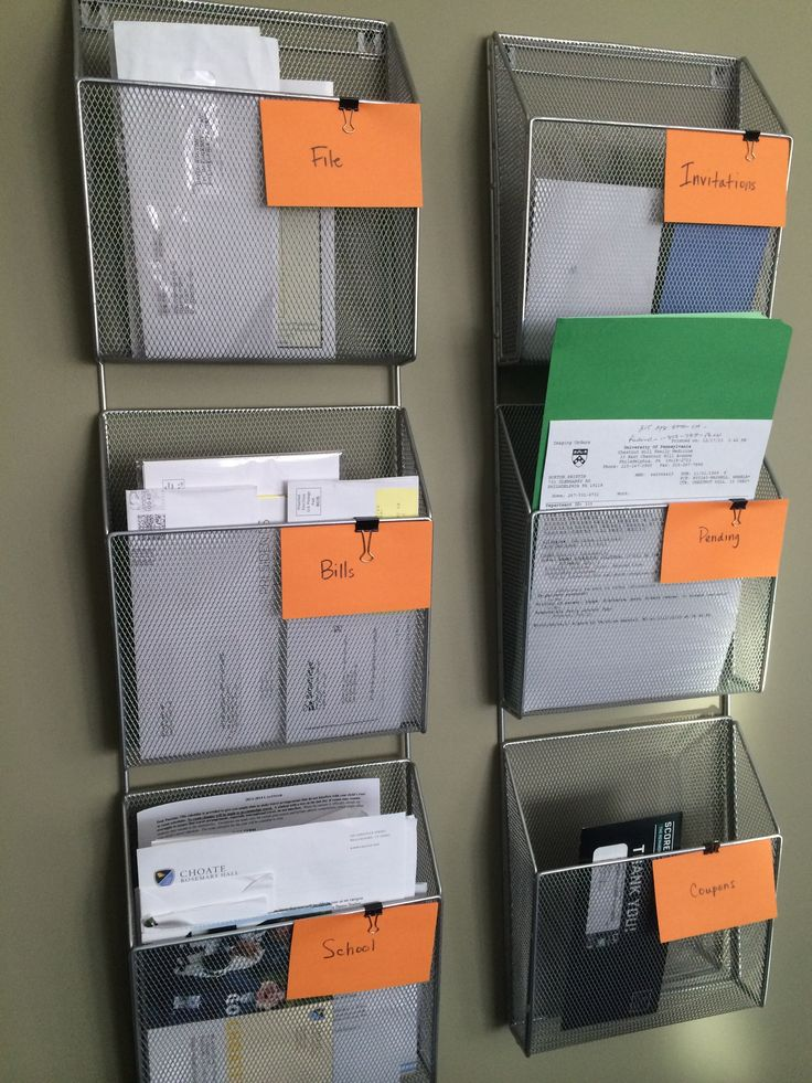 Use magazine wall racks (which are bigger which are bigger than the standard bill organizers) Kristina louisa