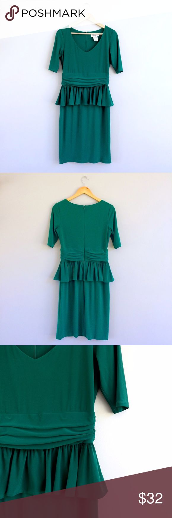 Retro Peplum Fitted Dress So retro, so adorable!! This kelly green peplum fitted v-neck dress will make you feel divine this holiday season! Just add a sparkly statement necklace and some fantastic heels and you're ready to hit the town. Bust: 17in, waist: 14in, shoulder to hem: 39in (knee/midi length on most women). Polyester/spandex blend for the perfect fit! Gently worn, great condition. Dresses Midi