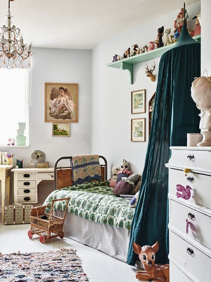 Vintage Bedroom: A charming child's bedroom with tons of vintage charm, from the iron bedfram to the unique toys and artwork. Photo Credit: Elle Decoration