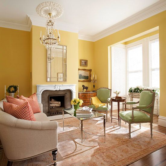 Bathed in light from the bay window, buttery yellow walls keep the large  space from
