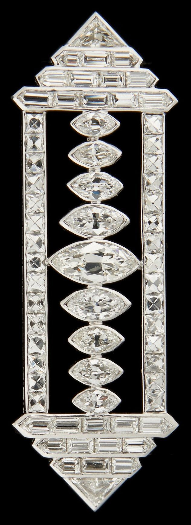 An Art Deco platinum and diamond brooch, set with marquise and calibré diamonds weighing approximately 12 carats. #ArtDeco #brooch