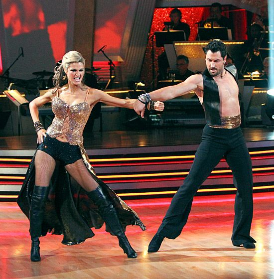 Erin Andrews  Before she became co-host of DWTS, the sportscaster worked the dance floor in a sparkly corset top and black booty shorts while performing with partner Maksim Chmerkovskiy during the tenth season in 2010.