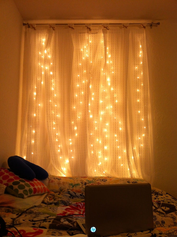 DIY Headboard :) Christmas Tree Lights, A Mounted Curtain Rod And Curtains  Hanging Over