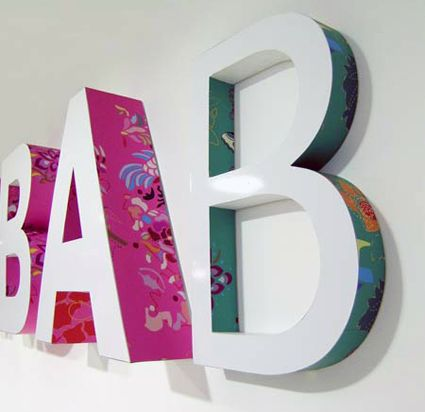 Zaijia Design. #signage #design #sign #letters #3D #white #colorful #pattern #wall #wayfinding #B #A