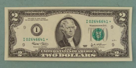 two dollar bills. Introduced in 1862 and discontinued in 1966. Was reintroduced again 1976. This example is a copy of the current two dollar bill which is still in circulation.