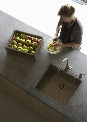 Cement counter tops. I'd put them with dark rich cabinets