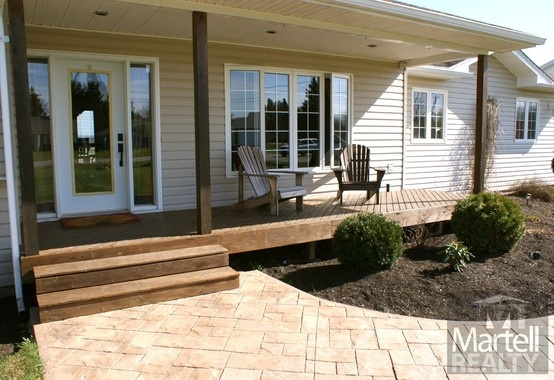 Want a gorgeous home on a 1.37 Acre waterfront lot? You just found it! 14 Parkin Street welcomes you home with inviting landscaping & a lush lawn for children to run and play on. Bring your canoe because your new home comes with waterfront. Parking is a breeze, in the 24' x 26' garage or on the large double paved drive. Stamped concrete pathways lead you onto the large front porch.