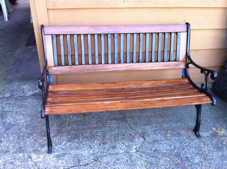 Tired old bench: used boards from old bed frame, stain and black spray paint.  My husband's project and he did all for $25.