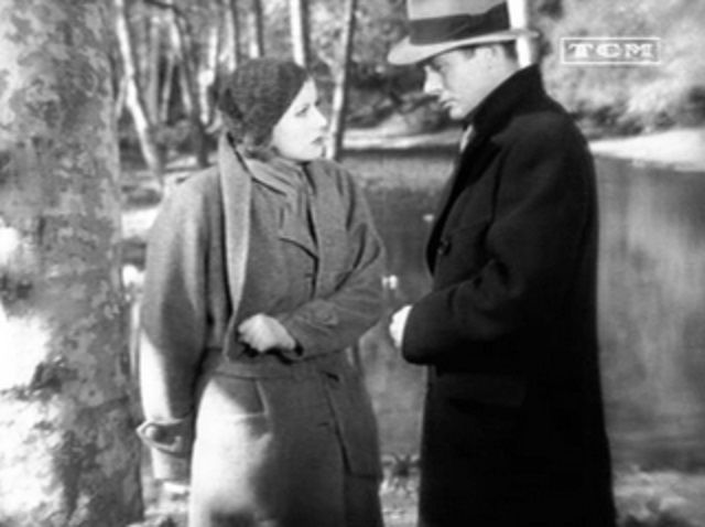 """Greta Garbo and Robert Montgomery in the 1931 movie, """"Inspiration"""". Garbo's coat is featured in the blog post """"Coats by Adrian"""" of Crème de la Crème."""