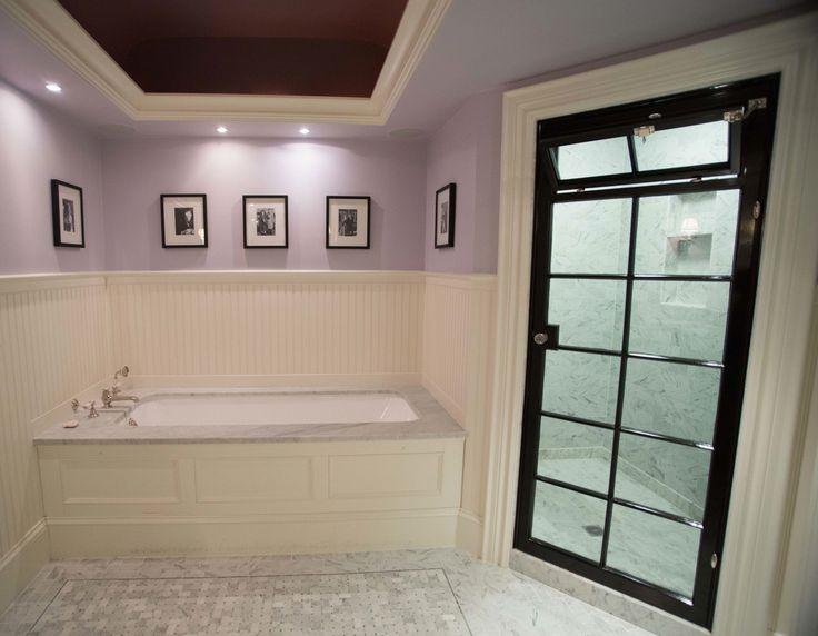 Hand-cut and hand-laid marble tile bath, custom shower door