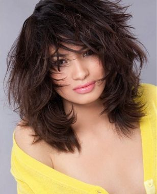 A brown straight coloured shaggy messy Layered hairstyle