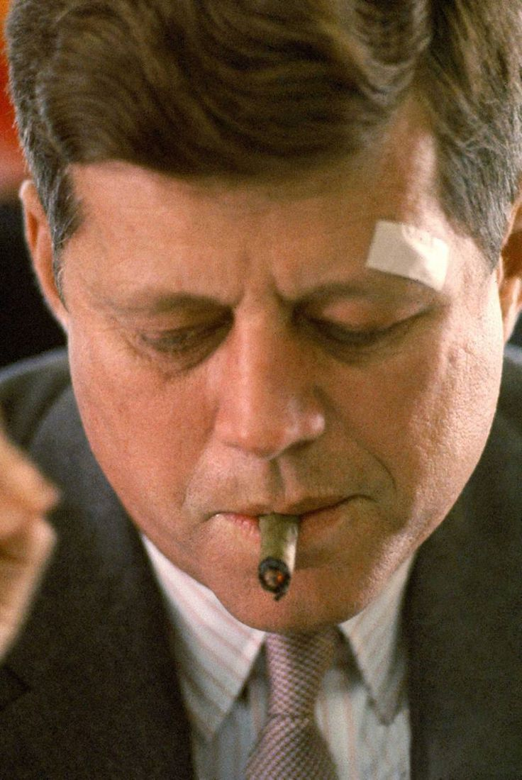 President John F. Kennedy with a cigar and a bandage, photographed by Paul Schutzer (1961)
