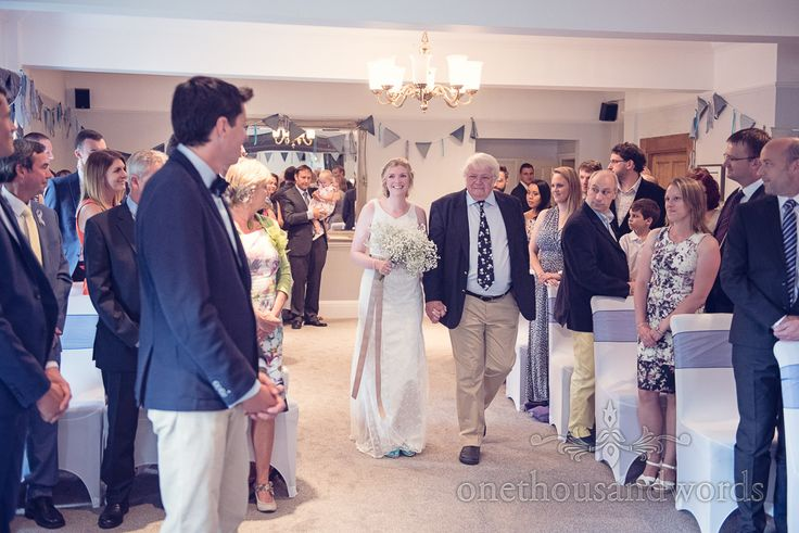 Bride is walked up the aisle by her father at Balmer Lawn Hotel Wedding ceremony. Photography by one thousand words wedding photographers