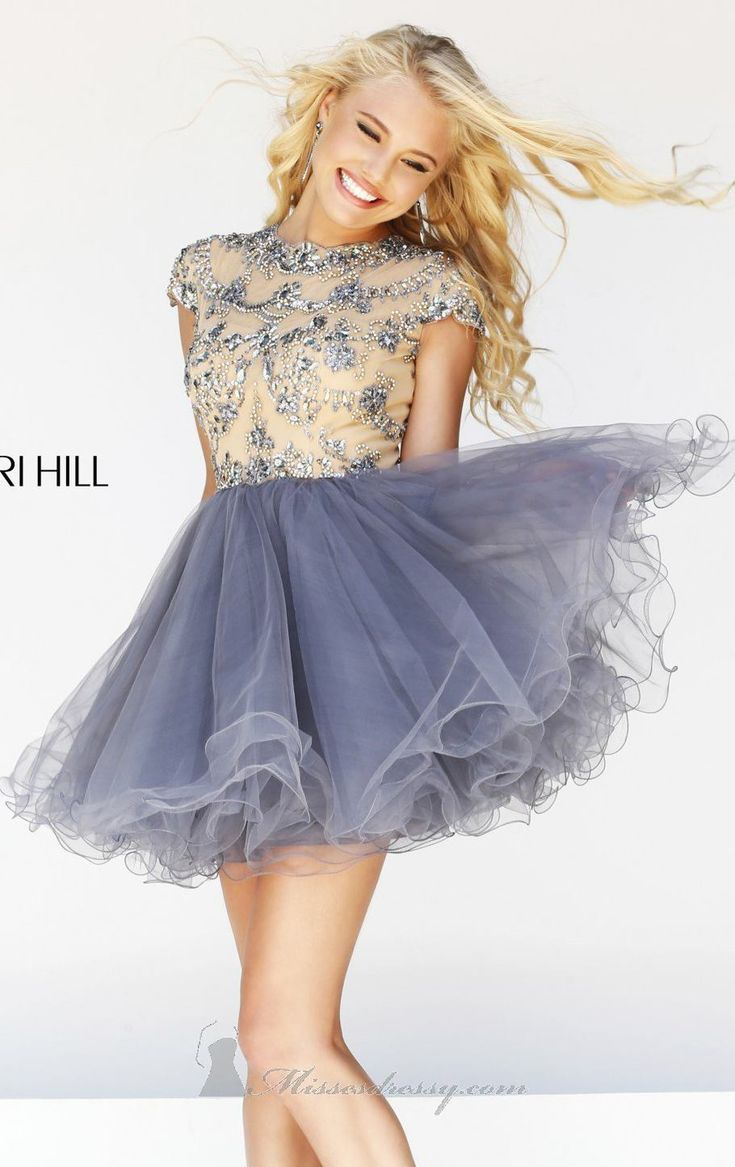 Look your best with Sherri Hill 21304. This breathtaking cocktail dress offers a jewel neckline with sort cap sleeves. Intricate embellishments scattered all over the bodice for a vibrant elegant look. The flared airy skirt is trimmed with curled hemline.