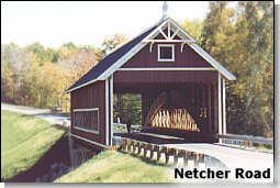 """Ashtabula County Ohio Covered Bridge Festival  1. Netcher Road Bridge (2.7 miles from Jefferson)  The bridge is constructed over Mill Creek in Jefferson Township, and it features a timber arch with inverted Haupt walls. The """"Neo Victorian"""" design structure is 110 feet long, 22-feet wide, and 14-feet, six inches high. Construction started in 1998, and it was funded by an ODOT Timber Grant."""