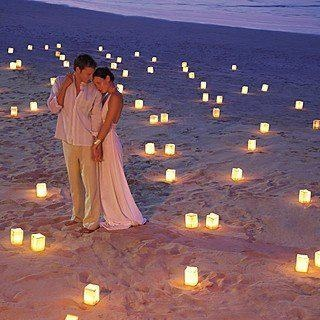 Want to add some romance to your beach reception? Have a look at these luminaries...never thought paper bags could look so nice!