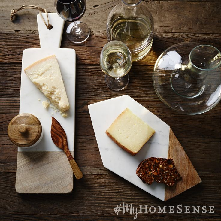 Host a stylish harvest get-together with rustic marble and wood serving trays - perfect for a Thanksgiving cheese course.